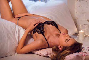 Teasing Girl In Bed Spreading LEgs